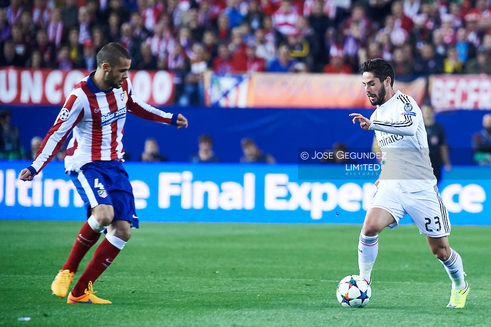 Mario Suarez and Isco (Real Madrid F.C.) in action during the Champions League, round of 4 match between Atletico de Madrid and Real Madrid at Estadio Vicente Calderon on April 14, 2015 in Madrid, Spain