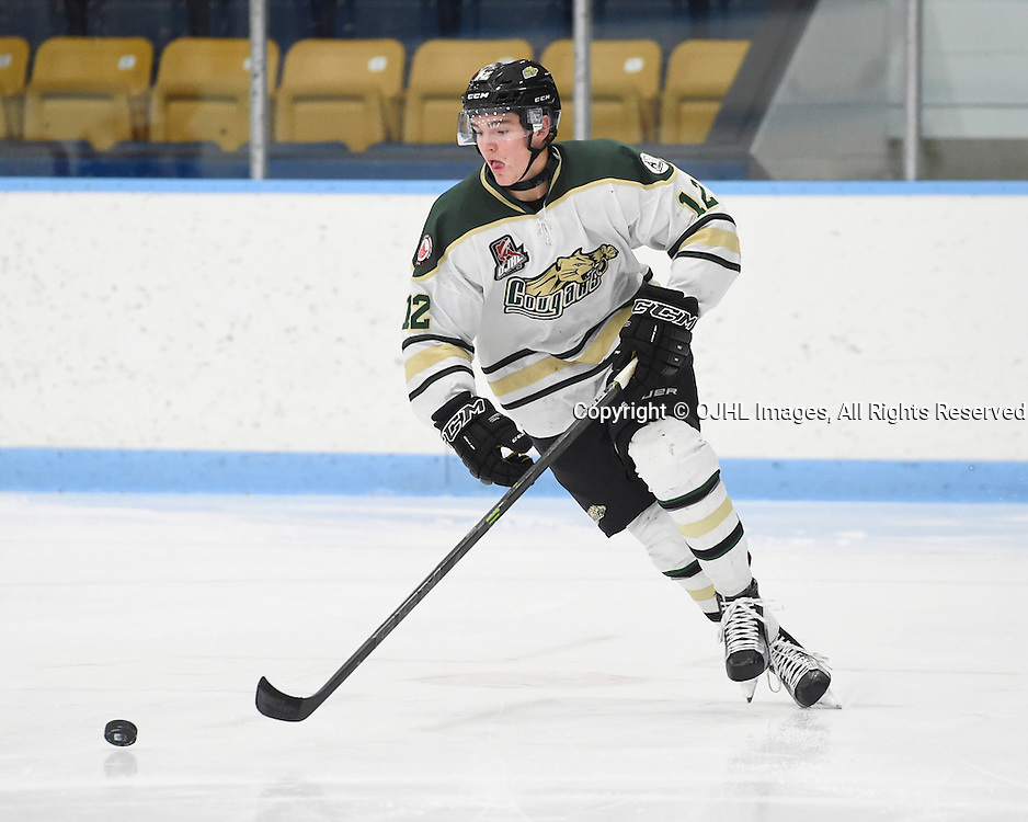 MARKHAM, ON - NOV 11,  2016: Ontario Junior Hockey League game between Cobourg and Markham, Jesse Baird #12 of the Cobourg Cougars skates after the puck during the second period.<br /> (Photo by Andy Corneau / OJHL Images)