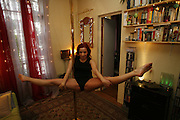 """Paris, France. December 4th 2007.Mariana practices Pole Dance in her apartment with her boyfriend Jean-Baptiste. She is the teacher of the """"Pole Dance Paris"""" school.. .Pole Dance Paris.Studio 77 .77 Rue de Montreuil.75011 Paris..www.poledance-paris.com"""