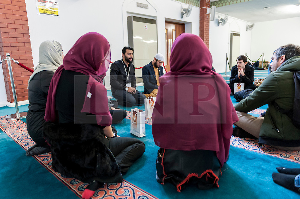 "© Licensed to London News Pictures. 07/02/2016. London, UK.  A tour guide addresses visitors in the prayer room.  The East London Mosque & London Muslim Centre, in the heart of Tower Hamlets, and home to the UK's largest Muslim community, opens its doors as part of ""Visit My Mosque Day"", a national initiative facilitated by the Muslim Council of Britain, where mosques across the UK organise open days to allow the British public to see what goes on in a mosque and to understand its role in Muslim life.  The aims are ""to reduce the 'unknown' or 'fear' factor for members of the British public with their local mosque and Muslim communities"". Photo credit : Stephen Chung/LNP"