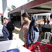 DECEMBER 1, 2017---HUMACAO, PUERTO RICO--<br /> Joan Diaz Velazquez, 18, a 2nd year microbiology student, does her laundry using loaner washer/dryers set up at the University of Puerto Rico's Humacao campus. Hurricane Maria damaged a lot of the structures and the school runs on generators since the power has not been restored.<br /> (PHOTO BY ANGEL VALENTIN/FREELANCE)