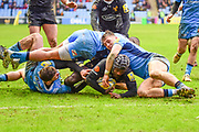 Wasps wing Christian Wade (14) is tackled just short by three London Irish players during the Aviva Premiership match between Wasps and London Irish at the Ricoh Arena, Coventry, England on 4 March 2018. Picture by Dennis Goodwin.
