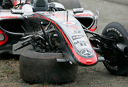 SPA FRANCORCHAMPS, BELGIUM - Sunday, August 30, 2009: The right wheel is stuck under the nose of Lewis Hamilton's McLaren Mercedes car after a crash during the Belgian Grand Prix at the  Circuit of Spa Francorchamps. (Photo by Juergen Tap/Hochzwei/Propaganda)