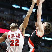 16 March 2012: Chicago Bulls forward Taj Gibson (22) vies for the rebound with Portland Trail Blazers small forward Luke Babbitt (8) during the Portland Trail Blazers 100-89 victory over the Chicago Bulls at the United Center, Chicago, Illinois, USA.