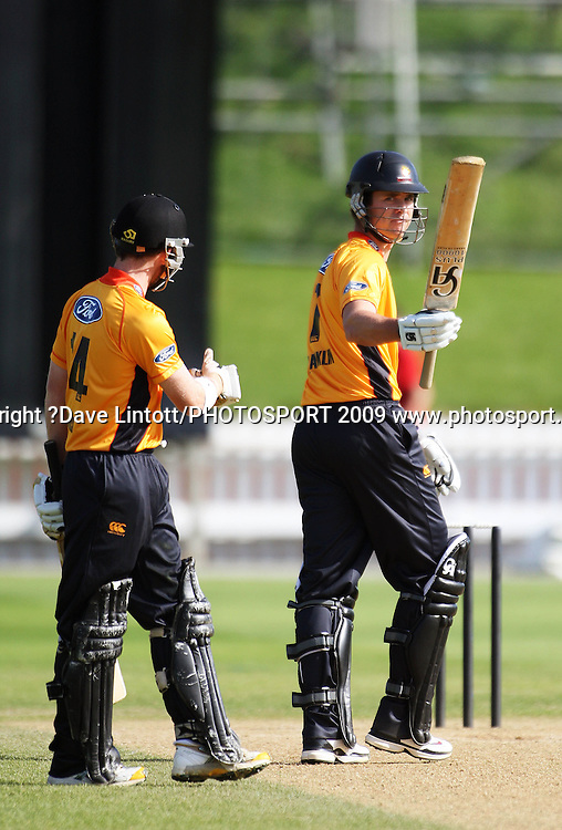 Wellington's Stewart Rhodes congratulates James Franklin on his half-century.<br /> One Day cricket - Wellington Firebirds v Central Stags at Allied Nationwide Finance Basin Reserve, Wellington. Thursday, 17 December 2009. Photo: Dave Lintott/PHOTOSPORT