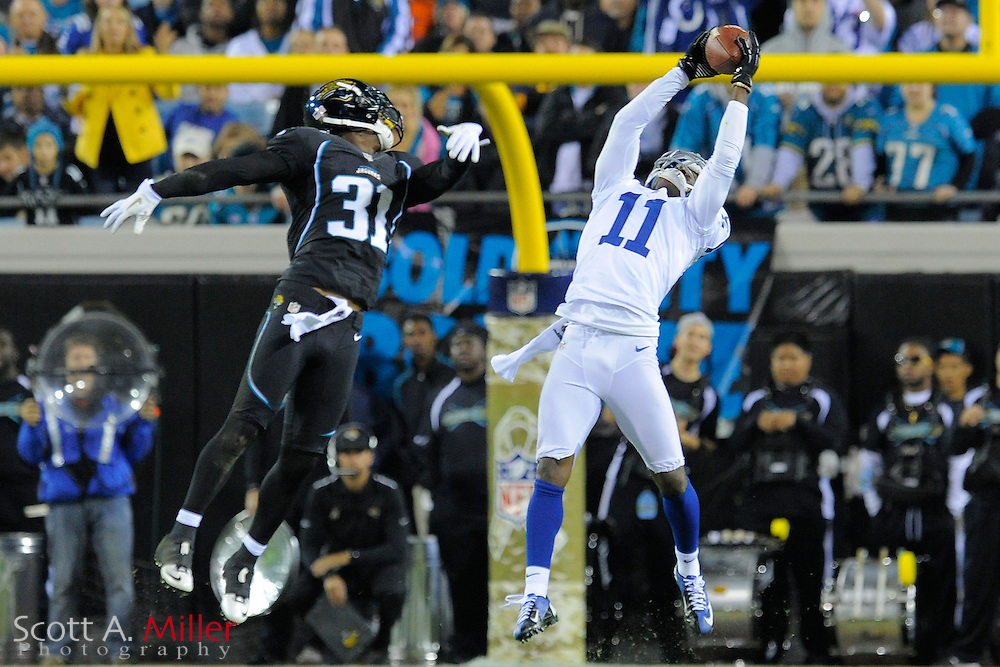 Indianapolis Colts wide receiver Donnie Avery (11) goes airborne to catch the ball as he is defended by Jacksonville Jaguars cornerback Aaron Ross (31) during the Colts 27-10 win at EverBank Field on November 8, 2012 in Jacksonville, Florida. ..©2012 Scott A. Miller..