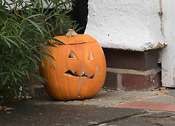 © Licensed to London News Pictures. 04/11/2017. London, UK. A Halloween pumpkin sits outside the front door of a house (C) in Wimbledon where a seven year old girl was found seriously injured on Friday and has since died. Robert Peters appeared at Wimbledon Magistrates' Court on Saturday and was charged with attempted murder.  Photo credit: Peter Macdiarmid/LNP