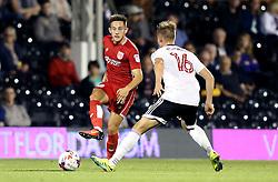 Josh Brownhill of Bristol City passes the ball past Cauley Woodrow of Fulham - Mandatory by-line: Robbie Stephenson/JMP - 21/09/2016 - FOOTBALL - Craven Cottage - Fulham, England - Fulham v Bristol City - EFL Cup