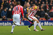 Arsenal defender Nacho Monreal challenges Stoke City forward Marko Arnautovic for the ball during the Barclays Premier League match between Stoke City and Arsenal at the Britannia Stadium, Stoke-on-Trent, England on 17 January 2016. Photo by Simon Davies.