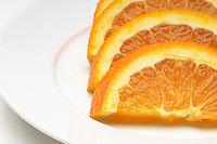 Sliced orange on plate, close-up