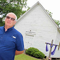 Bro. Ken Lockhart stands in front of New Hope Church, a historic church that has ranged from having large to small services to no activity at all for the past 115 years. With his new church, New Hope House of Prayer, he said he can feel the movement of God returning.