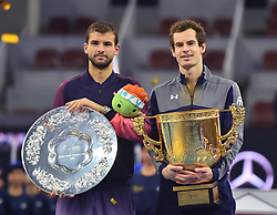 BEIJING, Oct. 9, 2016  Andy Murray (R) of Britain poses with Grigor Dimitrov of Bulgaria during the awarding ceremony for the men's singles final at the China Open tennis tournament in Beijing, capital of China, Oct. 9, 2016. Murray claimed the title of the event after beating Dimitrov 2-0. (Credit Image: © Li Wen/Xinhua via ZUMA Wire)