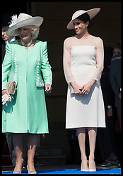 May 22, 2018 - London, London, United Kingdom - Image licensed to i-Images Picture Agency. 22/05/2018. London, United Kingdom. The Duchess of Cornwall and the Duchess of Sussex  at the Prince of Wales' 70th Birthday Patronage Celebration in the gardens of  Buckingham Palace in London. (Credit Image: © Stephen Lock/i-Images via ZUMA Press)