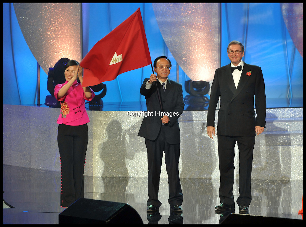Lord Ashcroft Hands over the Miss World flag to the host s of next years Miss World contest at the 2011 Miss World final at Earls Court London, Sunday November 6, 2011. Photo By  i-Images