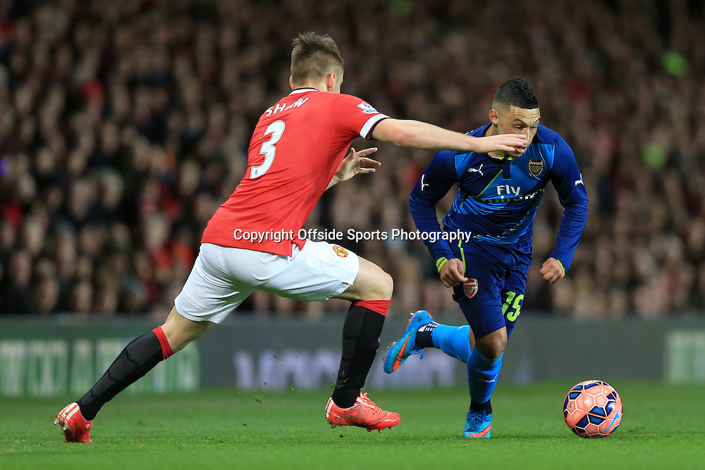 9th March 2015 - FA Cup - Quarter-Final - Manchester United v Arsenal - Luke Shaw of Man Utd battles with Alex Oxlade-Chamberlain of Arsenal - Photo: Simon Stacpoole / Offside.