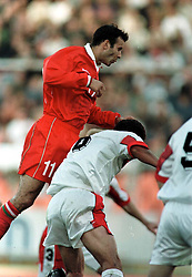 MINSK, BELARUS - Saturday, September 4, 1999: Wales's Ryan Giggs scores the winning goal against Belarus during the UEFA Euro 2000 Qualifying Group One match at the Dinamo Stadium. (Mandatory credit: David Rawcliffe/Propaganda)