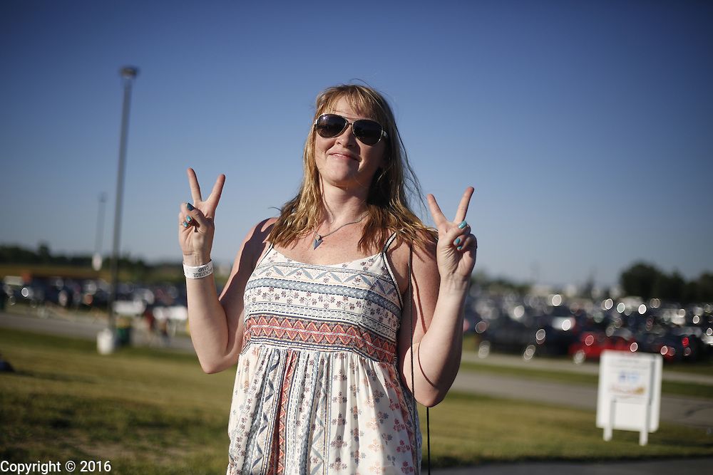06212016 - Noblesville, Indiana, USA: A Dead and Company fan gives peace signs in the parking lot of Klipsch Music Center (Deer Creek) before members of the Grateful Dead perform as Dead and Company. The Grateful Dead's final show at  Deer Creek in July 1995 was marred by over a thousand fans crashing the gates leading to the next day's show being canceled. Grateful Dead guitarist Jerry Garcia died a few weeks later. (Jeremy Hogan/Polaris)