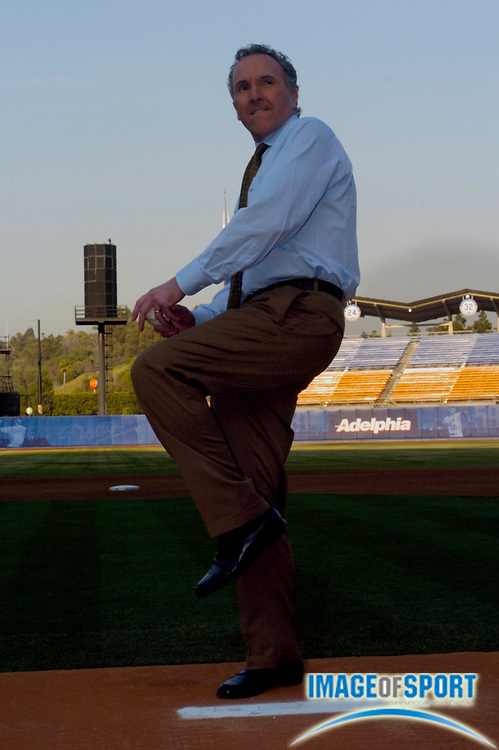 Jan 29, 2004; Los Angeles, CA, USA; Los Angeles Dodgers owner Frank McCourt throws a pitch at Dodger Stadium during press conference announcing his purchase of the team.