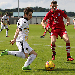 Chris Johnston sends a cross in during the Dumbarton v Connah's Quay Nomads Irn Bru cup second round 2 September 2017<br /> <br /> <br /> <br /> <br /> (c) Andy Scott | SportPix.org.uk