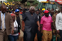 August 15, 2017 - Sierra Leone's President ERNEST BAI KOROMA (Front C) inspects the site of mudslide in Freetown, Sierra Leone. Government of Sierra Leone is expected on Tuesday to undertake the burial of the majority of corpses of victims in the devastating mudslide which had claimed nearly 300 lives. (Credit Image: © Wang Bo/Xinhua via ZUMA Wire)