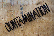 The word Contamination has been stencilled diagonally on a pane of glass in a building site in central London.