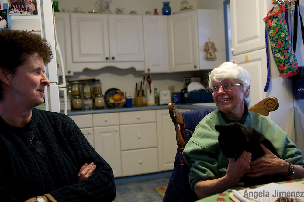 """Date: 1/08/09.Desk: STL.Slug: WOMYN.Assign ID: 30074969A..Sue Marriott, 52, left, visits with Emily Greene, 62, at Greene's home at Alapine, a """"womyn's land"""" or lesbian intentional community, in rural northeast Alabama. ...(*the exact town/location of the community cannot be revealed in the caption or article, per agreement with the subjects)..Photo by Angela Jimenez for The New York Times .photographer contact 917-586-0916"""