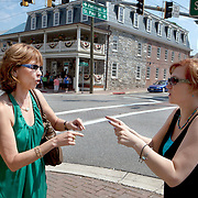"Best-selling author Nora Roberts talks to a fan about her latest book outside the Inn at Boonsboro, before a book-signing lunch in historic Boonsboro, Maryland. Ms. Roberts bought the 1790s-era building and created an eight-room boutique hotel meant to cater to women's romantic sides...Rooms are named for famous literary couples, including Marguerite and Percy of ""The Scarlet Pimpernel"" and Jane and Rochester from ""Jane Eyre."" Ms. Roberts spent $3 million renovating the three-story inn."