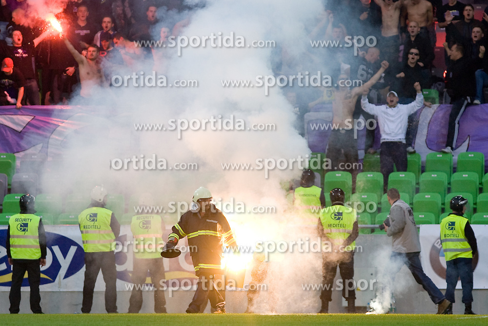 Fireman dealing with fireworks during the football match between NK Olimpija and NK Maribor, played in the 4th Round of Prva liga football league 2010 - 2011, on September 29, 2010, SRC Stozice, Ljubljana, Slovenia. (Photo by Matic Klansek Velej / Sportida)