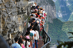 ZHANGJIAJIE, Sept. 7, 2016 (Xinhua) -- People walk on a glass corridor at the Tianmen Mountain National Forest Park in Zhangjiajie, central China's Hunan Province, Sept. 7, 2016.  (Xinhua/Long Hongtao) (zwx) (Credit Image: © Long Hongtao/Xinhua via ZUMA Wire)