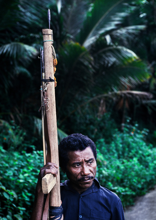 A pro-independence civilian with homemade spear gun. <br /> <br /> Many villagers had armed themselves against the pro-Indonesian militias, otherwise known as 'Mahidi', who are against independence and want to remain integrated with Indonesia.<br /> <br /> They were supported by the Indonesian military and continued to intimidate all supporters of independence by means of torture and killing. <br /> <br /> On the morning this picture was taken, which was Easter Monday 1999, scores of pro-independence militias descended on the town of Liquica, 35kms. south of Dili, with the intention of confronting the pro-Indonesian militias. <br /> <br /> By the end of the day between 11 and 17 independence supporters had been killed (the exact figure hasn't been confirmed). <br /> <br /> The sound of gunfire echoed around the town throughout the day, which implies that the Indonesian military were also involved either directly or by way of supplying arms to the pro-government militias.<br /> <br /> East Timor, March 1999.