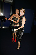 Alice Evans and Elizabeth Banks, Emporio Armani Red One Night Only. Brompton Hall, Earls Court. London. 21 September 2006.  . ONE TIME USE ONLY - DO NOT ARCHIVE  © Copyright Photograph by Dafydd Jones 66 Stockwell Park Rd. London SW9 0DA Tel 020 7733 0108 www.dafjones.com