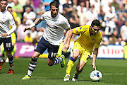 Prestons Joe Garner loses possession during the Sky Bet Championship match between Preston North End and Leeds United at Deepdale, Preston, England on 7 May 2016. Photo by Pete Burns.