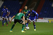 Freddie Ladapo of Oldham Athletic runs at Scunthorpe United defender Scott Wiseman (2) during the EFL Sky Bet League 1 match between Oldham Athletic and Scunthorpe United at Boundary Park, Oldham, England on 18 October 2016. Photo by Simon Brady.
