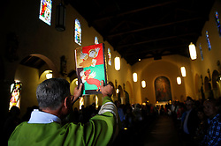 Parishioners of Sacred Heart Parish participate in the annual Portugal Day Festival in Salinas on Sunday. The event began with a colorful parade from Central Park to the church, featuring standard bearers, a traditional band, and beautifully dressed trios of young women representing area Portuguese communities. Women bore an icon of Saint Isabella, the patron saint of the poor, on a palanquin into the vestry of the church, where she would be crowned as a culmination of Sunday Mass. Princess Elizabeth, whose symbol is a rose, is also known as Isabel of Portugal. Born in Aragon, Spain, she was given as a teenager in marriage to Dennis of Portugal. She gave a great deal of her life to charitable causes, and was canonized as a saint in 1625 by Pope Urban VIII.