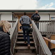 Jonathan Scott leads the way up to the stairs to his home site followed by members of the crew during a production day for the HGTV show, Brother vs Brother, Wednesday, February 15, 2017 in Galveston, Texas. Season five of the show which features The Property Brothers, Jonathan and Drew Scott, airs later this year.<br /> <br /> Todd Spoth for The New York Times.