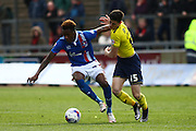 Carlisle United Defender Alexander McQueen and Oxford midfielder Callum O'Dowda battle for the ball during the Sky Bet League 2 match between Carlisle United and Oxford United at Brunton Park, Carlisle, England on 30 April 2016. Photo by Craig McAllister.