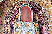Detail from an antique Buddhist altar with painted wood.