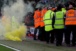 Watford fans throw yellow smoke bombs on the pitch - Mandatory by-line: Jason Brown/JMP - 21/01/2017 - FOOTBALL - Vitality Stadium - Bournemouth, England - Bournemouth v Watford - Premier League