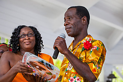 "Windy Fahie Donovan presents honoree Alvin Turnbull with a memorial plaque.  ""Alvin's Cultural Workshop"" Cultural Fair honoring Mr. Alvin Turnbull.  Emancipation Garden.  St. Thomas, VI.  29 April 2015.  © Aisha-Zakiya Boyd"