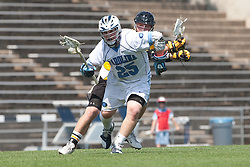 09 May 2009: North Carolina Tar Heels midfielder Shane Walterhoefer (25) during a 15-13 win over the University of Maryland - Baltimore County Retrievers on Fetzer Field in Chapel Hill, NC.