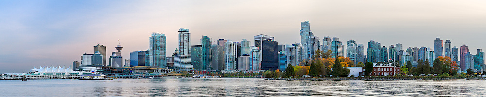 Panoramic photo of downtown Vancouver including the Trade and Convention Center, Canada Place, and HMCS Discovery on Deadmans Island -  as seen from Stanley Park in Vancouver, British Columbia, Canada