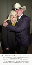 MR & MRS LARRY HAGMAN, he is the American actor who played JR in Dallas, at a party in London on 1st November 2001.	OTU 5