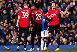 Harry Maguire of Manchester United talks to Scott McTominay and Aaron Wan-Bissaka of Manchester United - Mandatory by-line: Robbie Stephenson/JMP - 01/03/2020 - FOOTBALL - Goodison Park - Liverpool, England - Everton v Manchester United - Premier League