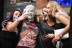 © Licensed to London News Pictures . 31/10/2015 . Manchester , UK . Women pose for a selfie with Pinhead . Halloween revellers , wearing make up and costumes , out and about in Manchester City Centre . Photo credit : Joel Goodman/LNP