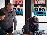 05 DECEMBER 2019 - DES MOINES, IOWA: People sign in for a campaign event with Senator Cory Booker (D-NJ). Senator Booker is running to be the Democratic nominee for the US Presidency in 2020. Iowa hosts the first selection event of the presidential election season. The Iowa caucuses are February 3, 2020.        PHOTO BY JACK KURTZ