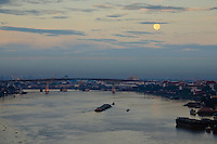 Full moon over the Chao Phraya River Bangkok ,Thailand.