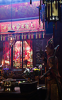 Smoke from incense lingers in the dimly lit Tin Hau Temple in Hong Kong.
