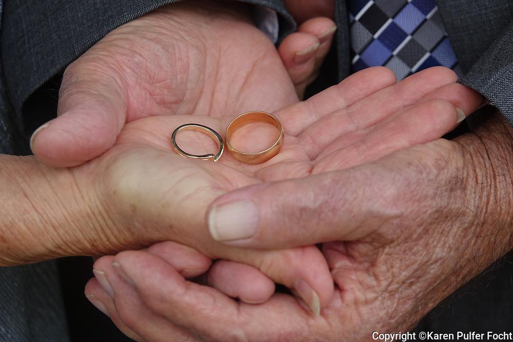 Elderly with wedding rings.