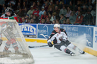 KELOWNA, CANADA - NOVEMBER 8: Matt Bellerive #14 of Vancouver Giants falls to the ice after taking a shot on net of the Kelowna Rockets during second period on November 8, 2014 at Prospera Place in Kelowna, British Columbia, Canada.   (Photo by Marissa Baecker/Shoot the Breeze)  *** Local Caption *** Matt Bellerive;