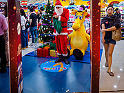 01 DECEMBER 2018 - BANGKOK, THAILAND: A Thai man in Santa Claus outfit waits to hand out small gifts to shoppers at the Toys R Us store in Central World in Bangkok. Toys R Us closed all of their brick and mortar stores in the United States in 2018 but kept many of their overseas stores open.    PHOTO BY JACK KURTZ